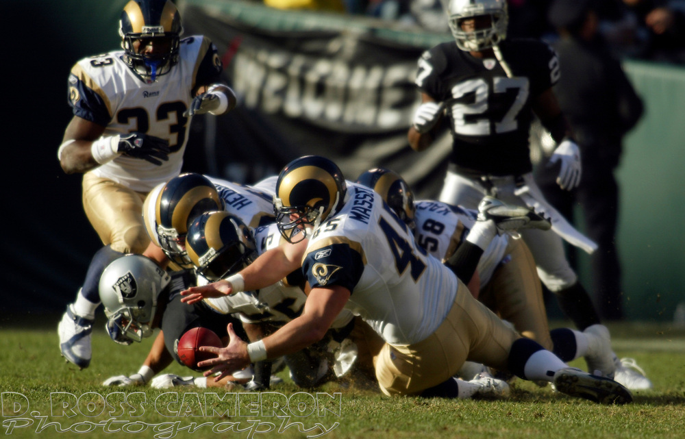 St. Louis Rams' Chris Massey (45) recovers the ball after Oakland Raiders punt returner Chris Carr muffed Matt Turk's punt, during the third quarter of an NFL football game, Sunday, Dec. 17, 2006 at McAfee Coliseum in Oakland, Calif. The Rams won, 20-0. (D. Ross Cameron/The Oakland Tribune)