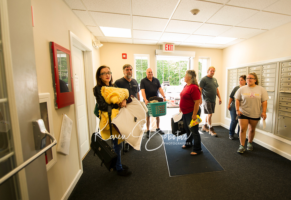 Move In day at the Apple Ridge student apartments for Lakes Region Community College Sunday morning.  (Karen Bobotas/for the Laconia Daily Sun)