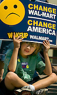 """8/16/06 Des Moines. IA Seven-year-old Satchel Perlowski holds a sign at an event Sen. Joseph Biden was speaking during an anti Wal Mart event in Des Moines Wednesday afternoon. Perlowski was there with his sister Stella, 4, and grandmother Karon.  SHE DOES SPELL KARON WITH AN """"O""""..(Chris Machian/Prairie Pixel Group)"""