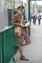 100 years to the day from when the celebrated Great War poet Wilfred Owen arrived for treatment in Edinburgh the ocassion was marked with a re-enactment of that arrival and the historic walk he made along Princes Street. Pictured is Wilfred Owen, played by David Clarke of the Scots in the Great War Living History Society arriving at Waverley Station in Edinburgh.<br /> <br /> © Dave Johnston/ EEm