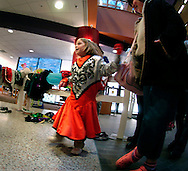 12/18/05  Omaha, NEThe holiday lights festival-Family Fun Festival.  A child plays dress-up with members of the Rose Theater at the W. Dale Clark.(photo by Chris Machian/Prarie Pixel Group)