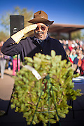 09 DECEMBER 2011 - PHOENIX, AZ:  JOHN ROGERS, a Buffalo Soldier reenactor, salutes a Christmas wreath during a wreath laying ceremony in Phoenix Saturday. Several hundred volunteers and veterans gathered at the National Memorial Cemetery of Arizona in Phoenix Saturday to lay Christmas wreaths on headstones, a tradition started by Wreaths Across America. Wreaths Across America is a nonprofit organization founded to continue and expand the annual wreath laying ceremony at Arlington National Cemetery begun by Maine businessman, Morrill Worcester, in 1992.   PHOTO BY JACK KURTZ