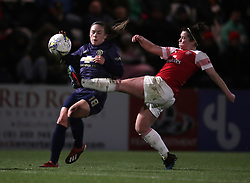 Arsenal Women's Emma Mitchell (right) and Manchester United Women's Kirsty Hanson battle for the ball