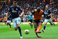 Benik Afobe has a shot during the Sky Bet Championship match between Wolverhampton Wanderers and Millwall at Molineux, Wolverhampton, England on 2 May 2015. Photo by Alan Franklin.