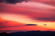 Sunset, red clouds, silhouette of Mountains, Tucson Mountain Park, Tucson, Arizona.©1989 Edward McCain. All rights reserved. McCain Photography, McCain Creative, Inc.