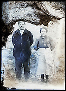eroding glass plate photo of farmers couple