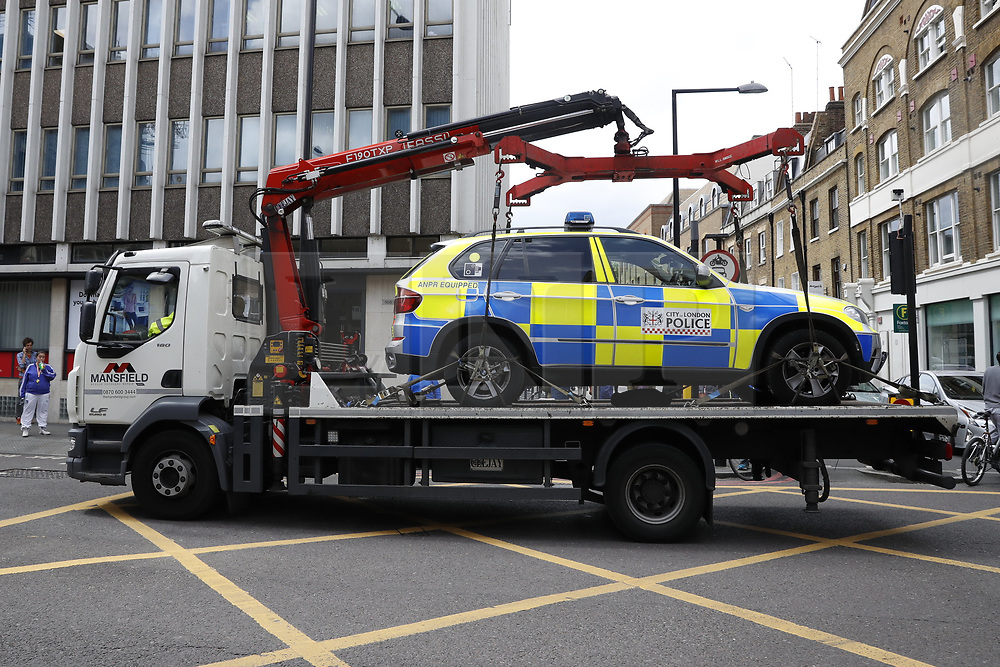 © Licensed to London News Pictures. 05/06/2017. London, UK.  A damaged police car is removed from Borough High Street following a terrorist attack in Saturday evening. Three men attacked members of the public  after a white van rammed pedestrians on London Bridge.   Ten people including the three suspected attackers were killed and 48 injured in the attack. Photo credit: Peter Macdiarmid/LNP