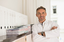 Portrait of male doctor smiling, Munich, Bavaria, Germany