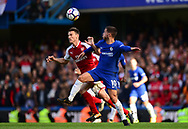 Laurent Koscielney of Arsenal battles with Eden Hazard of Chelsea. Premier league match, Chelsea v Arsenal at Stamford Bridge in London on Sunday 17th September 2017.<br /> pic by Andrew Orchard sports photography.