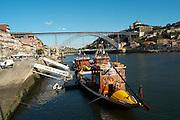 Dom Luis I bridge seen from Cais da Ribeira passenger ferry boat porto portugal