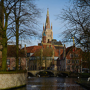 Dijver canal and Church of Our Lady from Begijnhof, Brugge, Belgium