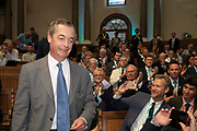 Delegates take photographs of Brexit Party leader Nigel Farage as he arrives to addresses party members and delegates at an event to introduce prospective parliamentary candidates in central London, United Kingdom on 27th August, 2019.