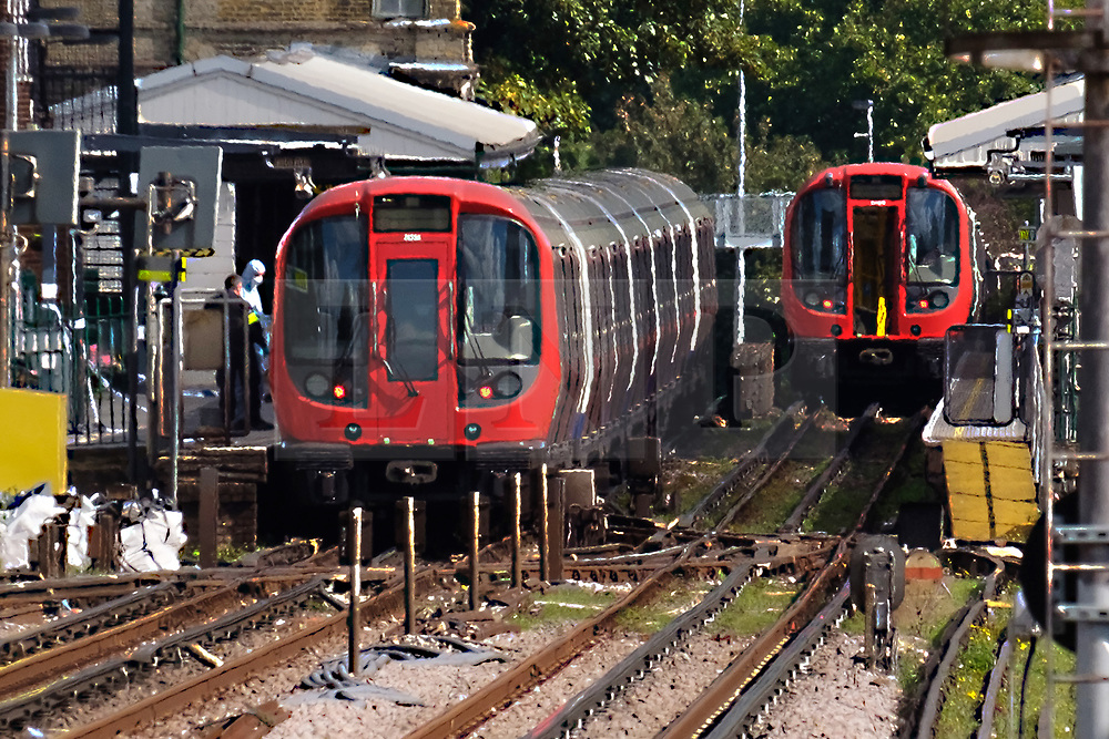 © Licensed to London News Pictures. 15/09/2017. London, UK. Forensics team respond to incident at Parsons Green Underground Station. Police and fire services gather at the scene of an home made bomb attack at Parson's Green District line tube station network. The home made bomb exploded near Parson Green tube station. Photo credit: Ray Tang/LNP