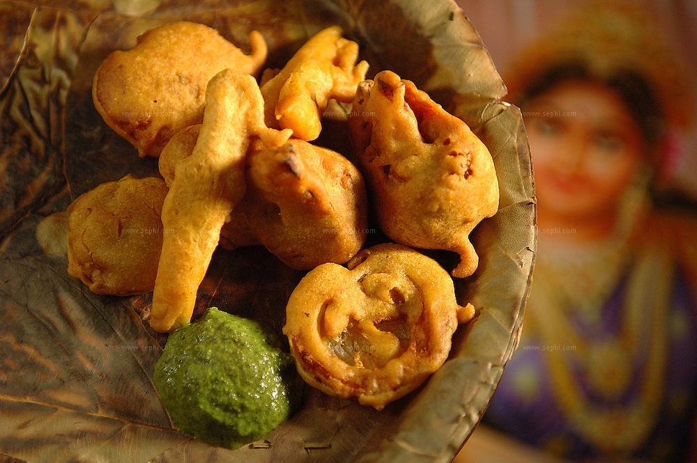 Besan Pakora - deep fried vegetables in gram flour batter ( Recipe available upon request )
