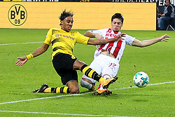 DORTMUND, Sept. 18, 2017  Pierre-Emerick Aubameyang (R) of Borussia Dortmund and Jorge Mere of 1.FC Cologne vie for the ball during the Bundesliga soccer match between Borussia Dortmund and 1.FC Cologne at the Signal Iduna Park in Dortmund, Germany on Sept. 17, 2017. Borussia Dortmund won 5-0. (Credit Image: © Joachim Bywaletz/Xinhua via ZUMA Wire)