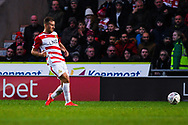 Herbie Kane of Doncaster Rovers (15) passes the ball forward during the The FA Cup fourth round match between Doncaster Rovers and Oldham Athletic at the Keepmoat Stadium, Doncaster, England on 26 January 2019.