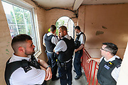 Police are standing by with a taser fearing that the man who is alleged to have assaulted members of the public and emergency worker in south London on Tuesday, Aug 18, 2020, would come out and attack them before he surrenders. <br /> Members of the MET police crew stormed into his barricaded doorstep after Martin wouldn't respond to their multiple calls to surrender as he was declared that he was going to be arrested.<br /> After breaking the door police stumbled into a barricade made of a ladder, washing machine, several chairs and other wood and plastic items. After forcing themselves into his apartment, police couldn't find him. The search is on-going. (VXP Photo/ Vudi Xhymshiti)