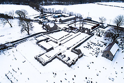 © Licensed to London News Pictures. 1/02/2019. Strata Florida, UK. The ruined Cistercian abbey at Strata Florida,  in Ceredigion, mid Wales, under a blanket of snow. Photo credit: Keith Morris/LNP