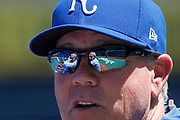 Kansas City Royals owner David Glass is reflected in the sunglasses of manager Ned Yost as they chat during batting practice before a baseball game against the Detroit Tigers at Kauffman Stadium in Kansas City, Mo., Saturday, May. 5, 2018. (AP Photo/Colin E. Braley)