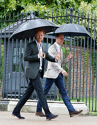 The Duke of Cambridge and Prince Harry leave following a visit to the White Garden in Kensington Palace, London, where they met with representatives from charities supported by Diana, the Princess of Wales.