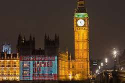 © licensed to London News Pictures. London, UK 02/12/2012. Hacked Off is promoting its petition in support of phone hack victims & the Leveson recommendations by projecting the counting clock showing numbers of signers on to the Houses of the Parliaments. Photo credit: Tolga Akmen/LNP