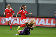 Grace Moloney, the Rep of Ireland goalkeeper saves from Natasha Harding of Wales.  Friendly International Womens football, Wales Women v Republic of Ireland Women at Rodney Parade in Newport, South Wales on Friday 19th August 2016.<br /> pic by Andrew Orchard, Andrew Orchard sports photography.