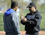 GLENDALE, AZ - FEBRUARY 23:  Manager Ozzie Guillen #13 (R) of the Chicago White Sox speaks with General Manager Ken Williams (L) during a spring training workout on February 23, 2010 at the White Sox training facility at Camelback Ranch in Glendale, Arizona. (Photo by Ron Vesely)