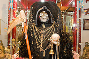 05 NOVEMBER 2004 - MEXICO CITY, MEXICO:  A statue of Santa Muerte (St. Death) in Iglesia de la Piedad (Mercy Church) in the Tepito section of Mexico City. St. Death is venerated throughout Mexico and Mexican communities in the United States. The veneration of St. Death started in Mexico's prisons about 10 years and has since spread through working class neighborhoods in many Mexican cities. The worship St. Death was recognized as an official by the Mexican government in 2003. The Catholic Church in Mexico is opposed to the worship of St. Death and has held rallies and prayer vigils against the Saint. The small church in Tepito is frequently swamped with visitors and the religion has spread quickly through the tough, drug and crime plagued neighborhood, widely considered the most lawless in Mexico City.  PHOTO BY JACK KURTZ