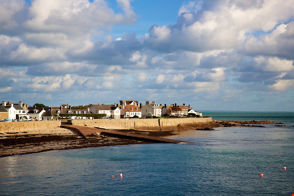 Houses overlooking the beach and slipway at La Rocque at high tide, Jersey, Channel Islands