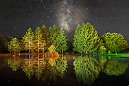 Tucked away in the Allegheny Mountains of West Virginia, Davis is a rare example of a small town where the Milky Way can be seen from within the city limits, as it is here reflecting in this pond in the park.