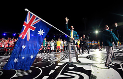 Australia's flag bearer Mark Knowles leads out his team during the Opening Ceremony for the 2018 Commonwealth Games at the Carrara Stadium in the Gold Coast, Australia.