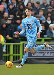 Coventry City's Tom Bayliss brings the ball forward