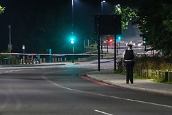 © Licensed to London News Pictures. 19/09/2021. London, UK. A police officer maintains a cordon on Kidbrooke Park Road in Greenwich following a call at 17:32BST on Saturday 18/09/2021 to Cator Park where the body of a female was found near the community centre. A man was arrested several hours later at approximately 21:20BST at an address in Lewisham on suspicion of murder and was taken into custody at a south London police station. Photo credit: Peter Manning/LNP