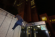 """Tokyo parkour coach and Tajikarao founder, Jun """"Sullivan"""" Sato. Shinjuku, Tokyo, Japan, January 10, 2012. Parkour is a modern method of physical training, also known as freerunning. It was founded in France in the 1990s. There is a small group of around 50 parkour practitioners in Tokyo."""