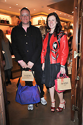 GILES DEACON and KATIE GRAND at the opening of Loewe's new boutique at 125 Mount Street, London on 23rd March 2011.