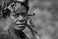 Captivating Batwa woman with her iconic look from a historical period. Transports one back to the movie Color Purple.
