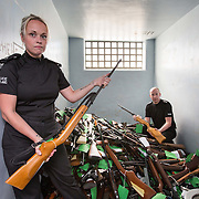 Tens of thousands of airguns will be held illegally in Scotland within weeks because just 8,000 have applied for licences.<br /> <br /> Anyone not complying with the new law that comes into effect on Dec31st faces a fine or up to 2 years in prison. <br /> <br /> Chief Inspector Craig Smith (R) local area commander East Dunbartonshire and PC Charlene Miller, inside a cell in Kirkintilloch Police Station with approx 600 weapons that have been handed in to the Greater Glasgow Division as part of Police Scotland's air weapons surrender.  Picture Robert Perry 8th June 2016<br /> <br /> Must credit photo to Robert Perry<br /> <br /> FEE PAYABLE FOR REPRO USE<br /> FEE PAYABLE FOR ALL INTERNET USE<br /> www.robertperry.co.uk<br /> NB -This image is not to be distributed without the prior consent of the copyright holder.<br /> in using this image you agree to abide by terms and conditions as stated in this caption.<br /> All monies payable to Robert Perry<br /> <br /> (PLEASE DO NOT REMOVE THIS CAPTION)<br /> This image is intended for Editorial use (e.g. news). Any commercial or promotional use requires additional clearance. <br /> Copyright 2016 All rights protected.<br /> first use only<br /> contact details<br /> Robert Perry     <br /> 07702 631 477<br /> robertperryphotos@gmail.com<br />         <br /> Robert Perry reserves the right to pursue unauthorised use of this image . If you violate my intellectual property you may be liable for  damages, loss of income, and profits you derive from the use of this image.