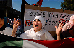 Brussels, Belgium - September 14, 2003 - Belgian Muslim community demonstrated against the decision of a school in Brussels which started to enforce a rule not allowing Muslim female students to wear their head scarfs. (PHOTO © JOCK FISTICK)