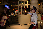 CHANGSHA, CHINA - OCTOBER 21: (CHINA OUT)<br /> <br /> Cooks Dance For Customers <br /> <br /> Cooks and waiters wearing dark glasses dance for customers at a restaurant on October 21, 2014 in Changsha, Hunan Province of China. They perform twice everyday as a tradition in the restaurant. <br /> ©Exclusivepix