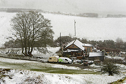 © Licensed to London News Pictures. 30/01/2021. Llanfihangel Nant Melan, Powys, Wales, UK. A wintry scene as Powys gets hit by strong winds and snow near Llanfihangel nant Melan in Powys, Wales, UK. Photo credit: Graham M. Lawrence/LNP