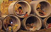 BINZHOU, CHINA - JUNE 18: (CHINA OUT) <br /> <br /> How Migrate Workers Keep Cool<br /> <br /> Migrate workers lay in cement pipes to keep cool on June 18, 2013 in Binzhou, Shandong Province of China. <br /> ©Exclusivepix