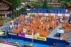 10-07-2011 VOLLEYBAL: FIVB WORLD TOUR BEACHVOLLEYBAL: GSTAAD<br /> Overzicht van het Center Court, publiek support met regencapes, illustratief<br /> ©2011-www.FotoHoogendoorn.nl / Peter Schalk