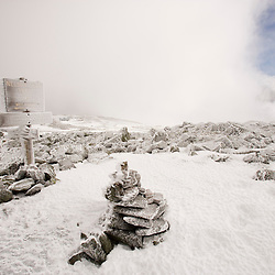 Rime ice covers the rocks and a trail sign on Mount Washington in New Hampshire's White Mountains.