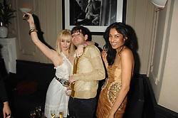 Left to right, ELLIE SHEPHERD, RICHARD DENNEN and SALONI LODHA at a leaving party for Poppy Delevigne who is going to New York to persue a career as an actress, held at Chloe, Cromwell Road, London on 25th January 2007.<br />