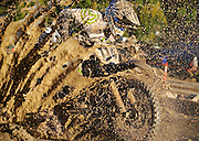 Gary Smith splashes through a muddy bog on his Yamaha YZ250F on Saturday at the second annual Jackson Hole Endurocross at the rodeo arena. Dirt riders from around the region convened for a night of rugged racing over downed logs, huge tires, jumps and other obstacles as they compete for a cash prize. See the Sports section for a story and more photos from the race.