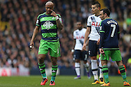 André Ayew of Swansea City (l) makes a point to Leon Britton of Swansea City (7).  Barclays Premier league match, Tottenham Hotspur v Swansea city at White Hart Lane in London on Sunday 28th February 2016.<br /> pic by John Patrick Fletcher, Andrew Orchard sports photography.