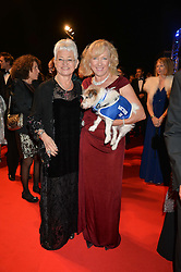 DAME JACQUELINE WILSON and CLAIRE HORTON Chief Executive of Battersea Dogs & Cats Home with her dog Wilma at Battersea Dogs & Cats Home's Collars & Coats Gala Ball held at Battersea Evolution, Battersea Park, London on30th October 2014.