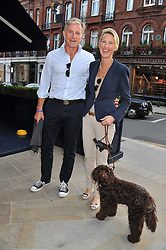 SIMON DAVIES and DANIELLE CROOK with their dog Fudge at the 10th anniversary of George in association with The Dog's Trust held at George, 87-88 Mount Street, Mayfair, London on 13th September 2011.