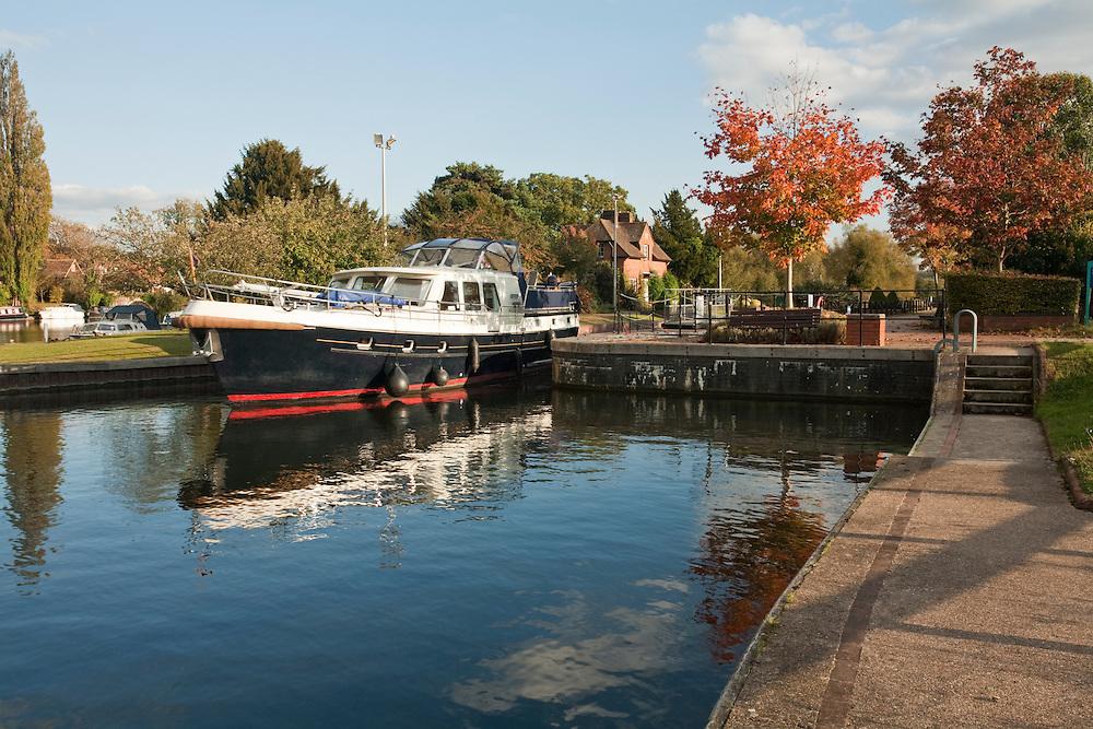 Pleasure cruiser emerging from Hambleden Lock near Henley, River Thames, Oxfordshire, Uk