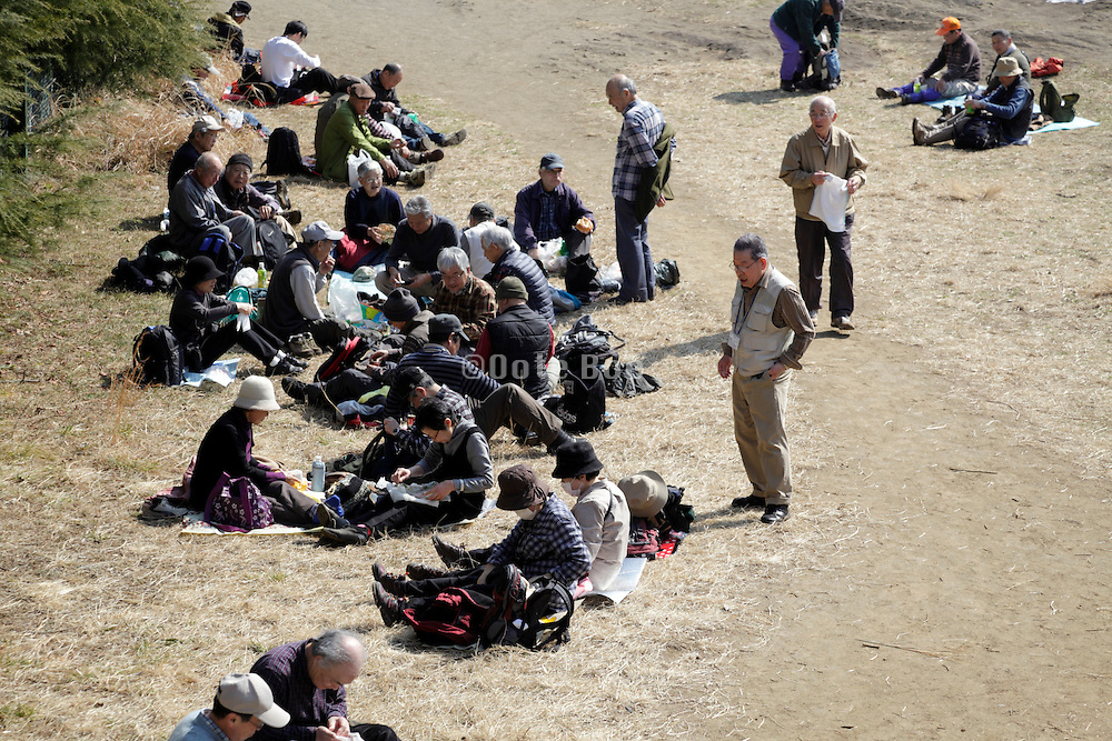 senior hiking club resting and picnicking Kamakura Japan